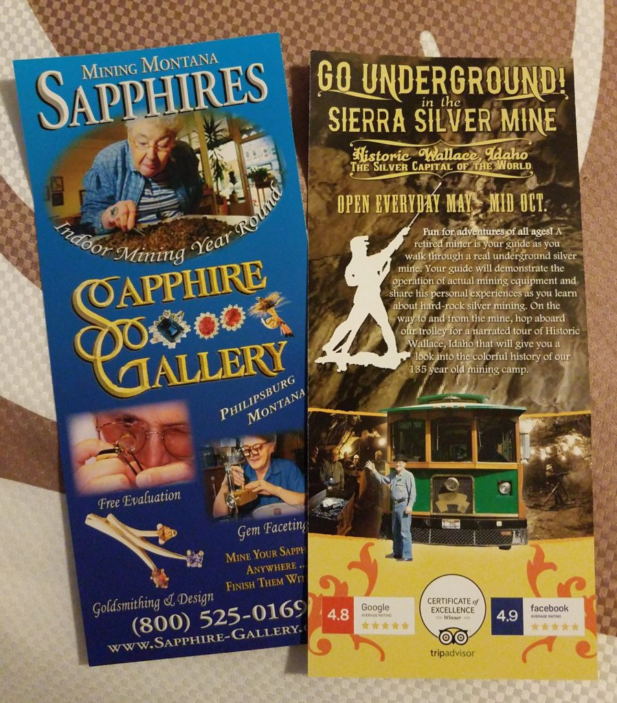 """Tourist brochures for a sapphire """"mining"""" attraction and silver mine tour."""